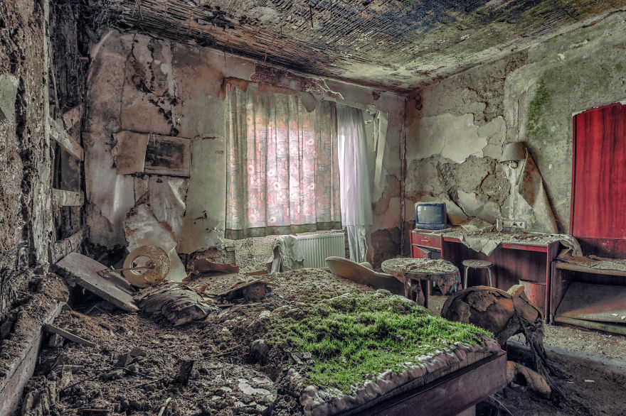abandoned decay bedroom with chair table tv in a hotel